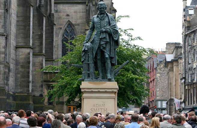 Crowds gather around a newly unveiled statue of the famous Scottish economist Adam Smith in Edinburgh